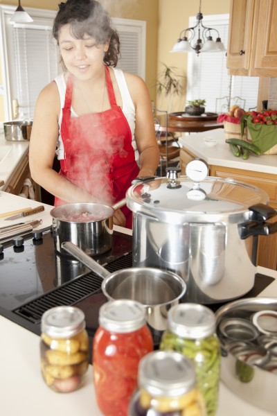 Canning: Mixed Race Young Adult Woman Preserving Homegrown Fruit